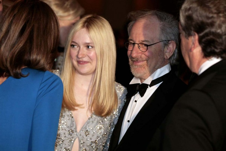 Director Steven Spielberg and actress Dakota Fanning attend the White House Correspondents Association annual dinner in Washington April 28, 2012. (Larry Downing/Reuters)
