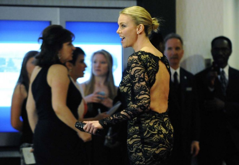 Actress Charlize Theron walks past reporters as she arrives on the red carpet for the annual White House Correspondents' Association Dinner at the Washington Hilton in Washington. (Jonathan Ernst/Reuters)
