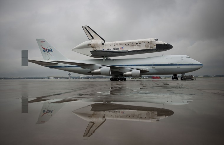 April 18, 2012: Space shuttle Discovery, mounted atop a NASA 747 Shuttle Carrier Aircraft (SCA) is seen a few hours before being demated at Washington Dulles International Airport, in Sterling, Virginia. Space shuttle Discovery, the first orbiter retired from NASA's shuttle fleet, traveled total 148,221,675 miles and will take the place of Enterprise at the center to commemorate past achievements in space and to educate and inspire future generations of explorers at the center. (NASA/Smithsonian Institution/Carolyn Russo/Reuters)