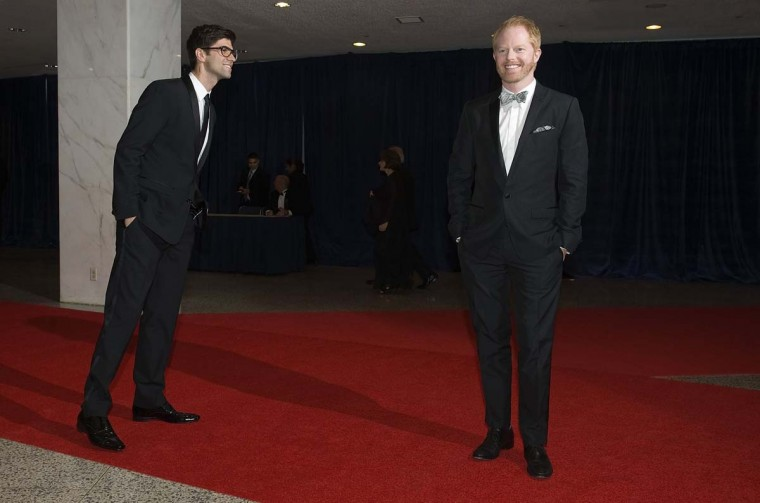 Actors Justin Mikita (L) watches as his partner Jesse Tyler Ferguson stop for photos on the red carpet at the annual White House Correspondents' Association Dinner at the Washington Hilton in Washington April 28, 2012. (Jonathan Ernst/Reuters)