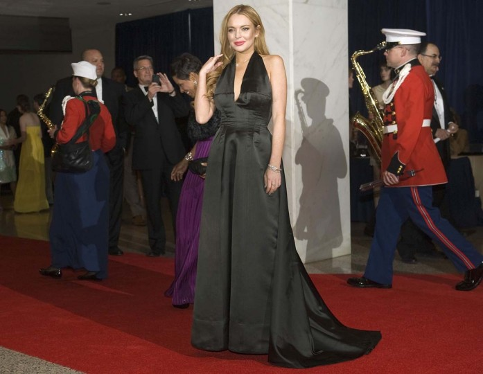 Lindsay Lohan arrives on the red carpet, as the U.S. Marine Band arrives behind her, for the annual White House Correspondents' Association Dinner at the Washington Hilton in Washington, April 28, 2012. (Jonathan Ernst/Reuters)