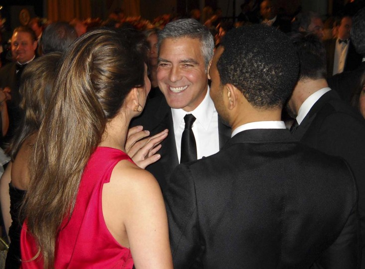 Actor George Clooney talks with other guests during the annual White House Correspondents' Association Dinner in Washington. (Jim Bourg/Reuters)