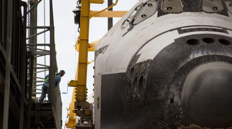 April 14, 2012: A space center worker watches over as Discovery is attached to the lifting harness in the mate-demate facility at Kennedy Space Center, Florida. Discovery will be mated with a converted 747 aircraft and flown up to it's final home at The Smithsonian National Air and Space Museum Steven F. Udvar-Hazy Center in Chantilly, Virginia. (NASA/Smithsonian Institution/Carolyn Russo/Reuters)