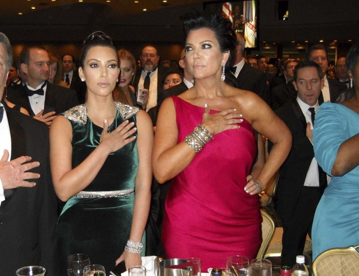 Kim Kardashian and her mother Kris Jenner hold their hands over their hearts for the U.S. national anthem during the annual White House Correspondents' Association Dinner in Washington April 28, 2012. (Jim Bourg/Reuters)