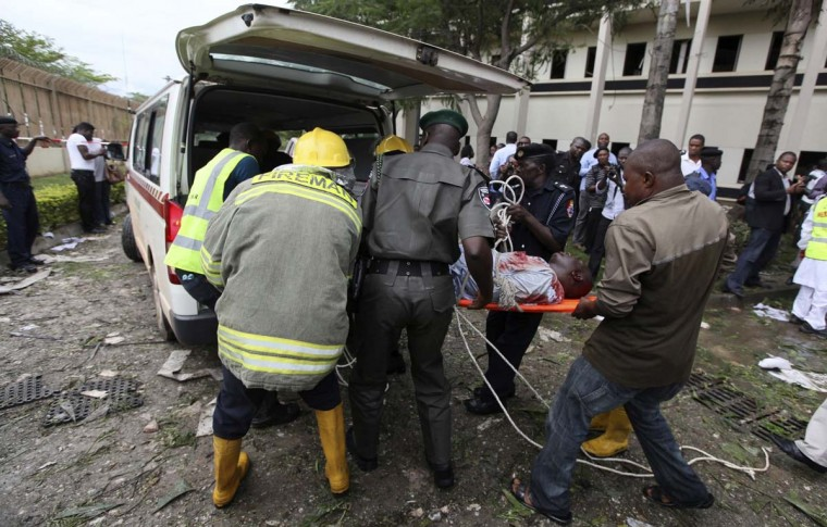 BOKO HARAM: A victim of a bomb blast, which ripped through the UN offices in Abuja, is loaded into an ambulance on August 26, 2011, after a car rammed into the building. The attack drew global attention to Boko Haram, the militant group from northern Nigeria, which claimed responsibility for the attack and a string of later bombings that killed hundreds. As the bombings have grown in frequency in recent months, the Nigerian government and Western security officials have begun to grapple with the exact nature of the threat. (Afolabi Sotunde/Reuters)