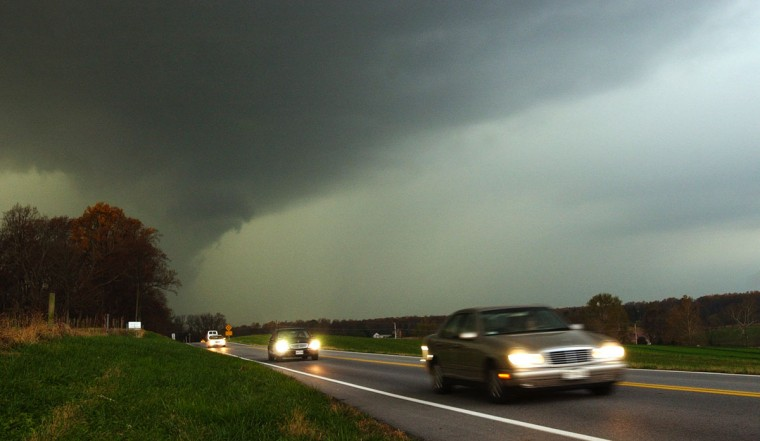 Motorists head eastbound on Homewood Road (east of Folly Quarter Road) in front of the leading edge of a line of severe storms that reportedly spawned a tornado in Montgomery County. (David Hobby/Baltimore Sun)