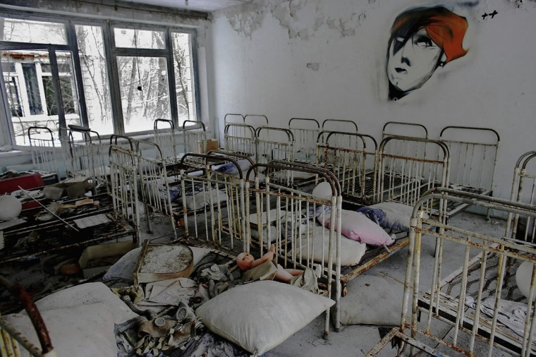 January 25, 2006: The remnants of beds are seen abandoned in a preschool in the deserted town of Pripyat, Ukraine. Scientists estimate that the most dangerous radioactive elements will take up to 900 years to decay sufficiently to render the area safe. (Daniel Berehulak/Getty Images)