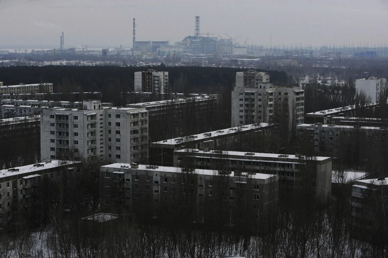January 25, 2006: The Chernobyl Power Plant is seen in the distance as the abandoned town of Pripyat stretches out in the foreground near Chernobyl. Prypyat and the surrounding area will not be safe for human habitation for several centuries. (Daniel Berehulak/Getty Images)