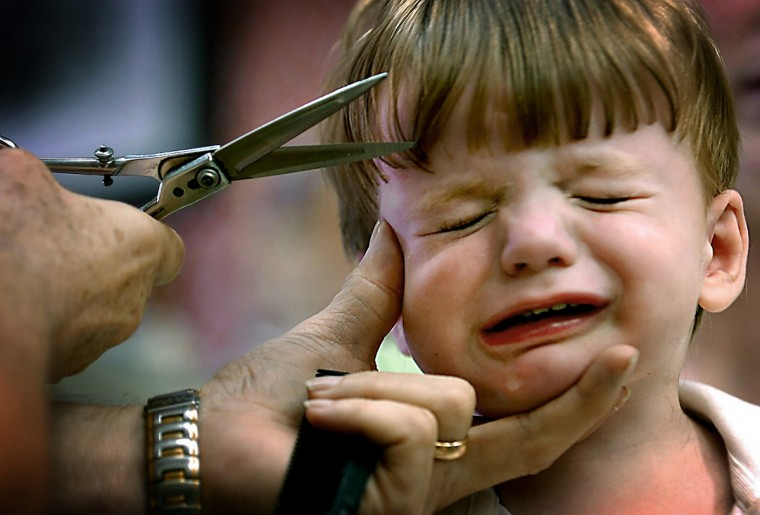 In August 2007, Patrick Corbett managed to not cry during his hair cut at Gennuso's barber Shop, until Barber Garry Oster went for the bangs. (Monica Lopossay/Baltimore Sun)
