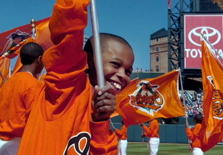 2005: Opening Day ceremonies begin as kids run out onto the field carrying Orioles' flags at the start of the player introduction. Opening Day at Camden Yards with Orioles and Oakland Athletics. (Lloyd Fox/Baltimore Sun) BUY THIS PHOTO