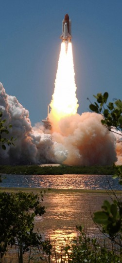 July 4, 2006: The space shuttle Discovery blasts off from launch pad 39B at the Kennedy Space Center in Florida. The Discovery shuttle rocketed seven astronauts into orbit on a pivotal mission for US space ambitions amid persistent concerns about safety since the 2003 Columbia tragedy. (HO/AFP/Getty Images)