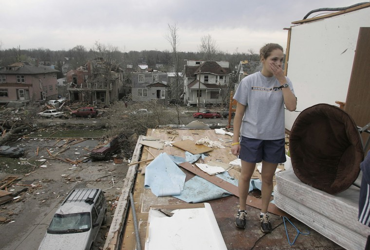 University of Iowa sophomore Jessica Fischels stands in the remains of her apartment in Iowa City, Iowa, Friday April 14, 2006, after it was destroyed by tornado Thursday night. (Matthew Holst/Iowa City Press Citizen/AP Photo)