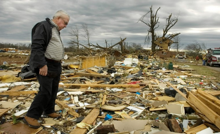 James Devaney searches through the debris of his daughter's home on County Rd. 183 in the Aldridge Grove community of Lawrence County, Alabama, Wednesday, Feb. 6, 2008. Devaney's daughter Becky Coleman was killed along with her son Gerreck and her husband Greg when the tornado hit at 3:06 a.m. (Gary Cosby Jr./The Decatur Daily,AP Photo)