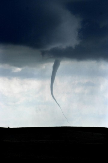 On the Pine Ridge Indian Reservation in South Dakota, a thin, rope-like tornado dips toward the ground on April 23, 2006. Come spring, tour participants traverse the highways and byways of the Great Plains, hoping to see such thrilling, and terrible, manifestations of nature. (Robin Rauzi/Los Angeles Times)