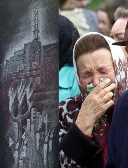 April 26, 2001: A relative of a worker who died following the clean-up operations for the 1986 Chernobyl nuclear explosion wipes tears away at the wreath laying ceremony at the Chernobyl's victim monument in Ukraine's capital of Kiev. On the left is a depiction of the sarcophagus. (Efrem Lukatsky/AP Photo)