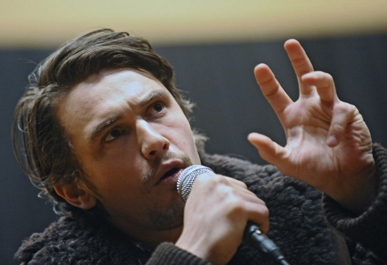 "Mar.11: Actor James Franco answers questions from Johns Hopkins students and faculty after a screening of the film ""The Broken Tower,"" which Franco acted and directed. (Kenneth K. Lam/Baltimore Sun)"