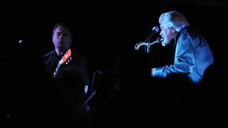 """""""Johnny Cat"""" Soubrand, left, plays electric guitar as Terry Hanck plays the alto sax while performing for the Baltimore Blues Society at the Rosedale American Legion Hall. (Robert K. Hamilton/Baltimore)"""
