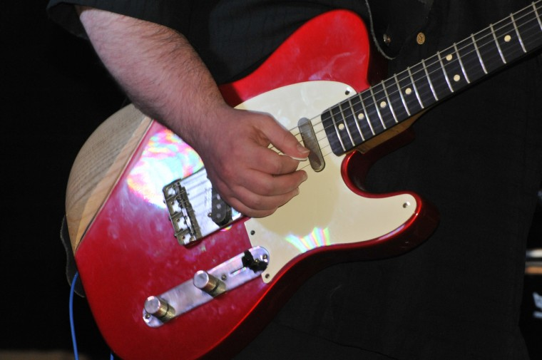 """""""Monster"""" Mike Welsh takes center stage and plays the electric guitar as Sugar Ray and the Bluetones perform for the Baltimore Blues Society at the American Legion Hall in Rosedalle. (Robert K. Hamilton/Baltimore)"""