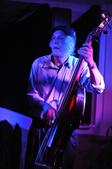 """Michael """"Mudcat"""" Ward plays the bass and lays down a beat with the Bluenotes as Sugar Ray sings the blues. (Robert K. Hamilton/Baltimore)"""