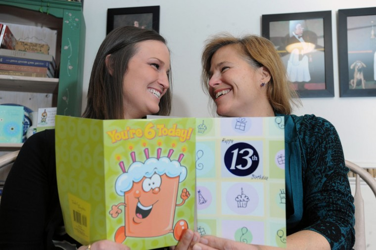 Feb. 29: Janet Cunningham, right, and her daughter Erin were both born on leap days only 28 years apart. They are pictured holding special birthday cards from the same relative. (Kenneth K. Lam/Baltimore Sun)