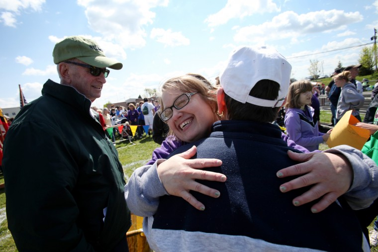 Ira Farber, left, watches as his daughter Therapeutic Recreation Council's Ilise Farber hugs her mother Roz Farber, right, after Illise won a medal for the 50 meter walk. (Jen Rynda/Patuxent Homestead)