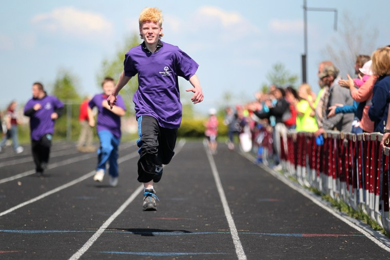 Westminster High School's Michael Davis, 16, races during the 100 meter race and places second in his heat. (Jen Rynda/Patuxent Homestead)