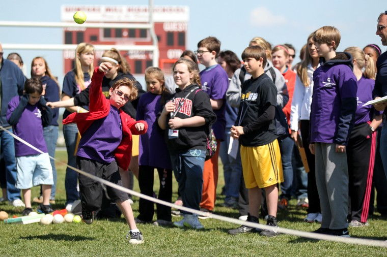 Freedom Elementary School's Cole Leverett, 10, throws a softball. (Jen Rynda/Patuxent Homestead)