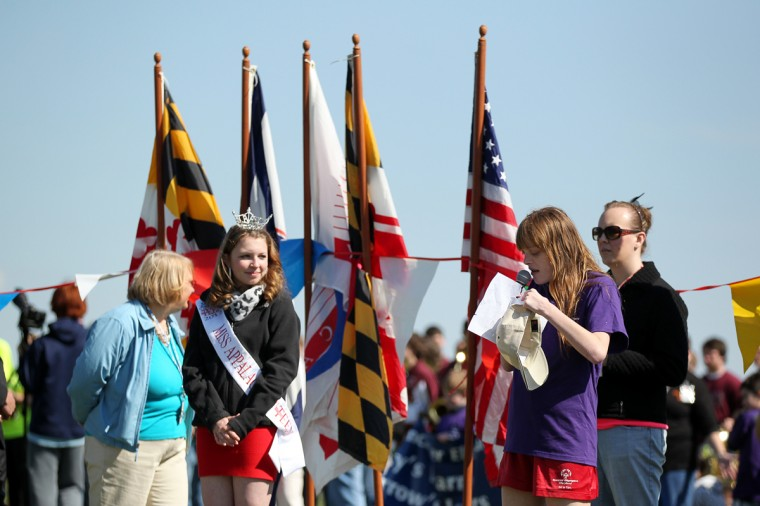 Therapeutic Recreation Council's Jessica Zuback, right, 16, reads The Athlete's Oath before the start of the Special Olympics Carroll County Spring Games at Winters Mill High School. (Jen Rynda/Patuxent Homestead)