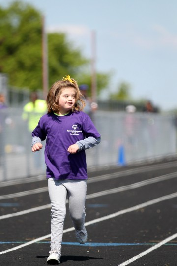 Westminster Elementary School's Riley Snyder, 10, races in the 100 meter run during the Special Olympics Carroll County Spring Games. (Jen Rynda/Patuxent Homestead)