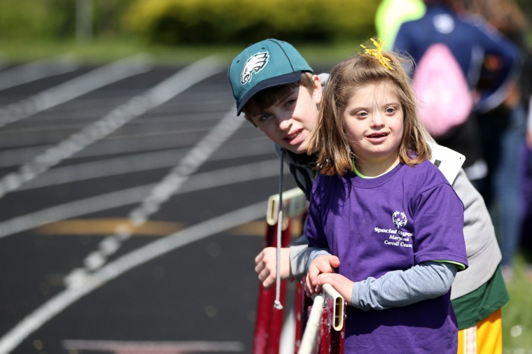 Tyler Snyder, 12, stands with his sister Westminster Elementary School's Riley Snyder, 10, right, during the Special Olympics Carroll County Spring Games at Winters Mill High School. (Jen Rynda/Patuxent Homestead)