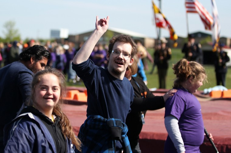 Liberty High School's Catherine Gardner, left, 17, and Nathan Carteaux, center, 18, walk during the opening ceremony. (Jen Rynda/Patuxent Homestead)