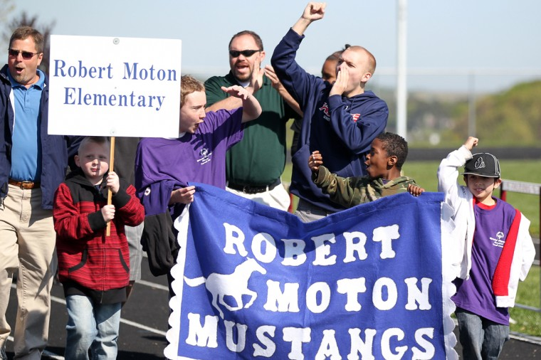 Robert Moton Elementary School walks on the track in the opening ceremony during the Special Olympics Carroll County Spring Games. (Jen Rynda/Patuxent Homestead)