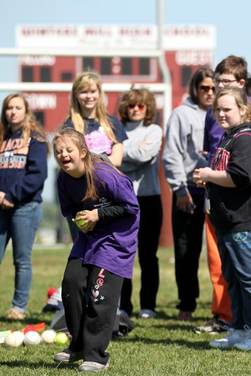 West Middle School's Sabrina Sabol, 12, has a laugh before throwing a softball during the Special Olympics Carroll County Spring Games. (Jen Rynda/Patuxent Homestead) West Middle School's Sabrina Sabol, 12, has a laugh before throwing a softball during the Special Olympics Carroll County Spring Games at Winters Mill High School in Westminster, MD on Wednesday, April 25, 2012.