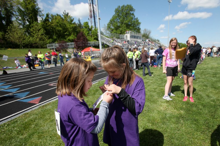 Westminster Elementary School's Riley Snyder, left, 10, checks out her friend West Middle School's Sabrina Sabol's, 12, ribbon during the Special Olympics Carroll County Spring Games at Winters Mill High School.