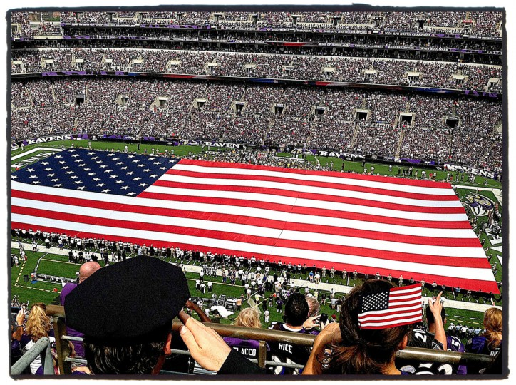 I took this picture on the opening day of Ravens season on 9/11/2011. I knew they were going to unfurl the giant flag on the field. The only tricky part was finding a position that added an additional element to the photograph. In this case the Baltimore City police officer. (Robert K. Hamilton/Baltimore Sun)