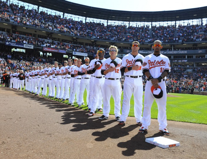 Orioles players line up during the opening ceremonies for the 20th anniversary of Oriole Park at Camden Yards. (Lloyd Fox/Baltimore Sun)