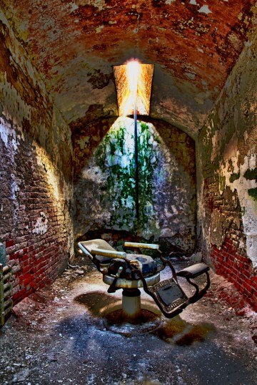 "Urban Decay: ""Barber's Chair"" by John Jake Jakubik -- Jake photographed ""Barber's Chair"" at Eastern State Penitentiary in Philadelphia with a Canon 7D DSLR camera. ""The photographer did a marvelous job of taking advantage of the great light created through an overhead window. That light accentuated the colors and the textures of the walls. Most importantly, the oddity of the barber's chair sitting in such a strange location really grabs the viewer."""
