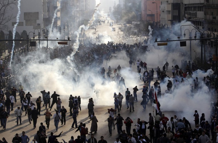 January 28, 2011: Protesters flee from tear gas fire during clashes in Cairo. Police and demonstrators fought running battles on the streets of Cairo in a fourth day of unprecedented protests by tens of thousands of Egyptians demanding an end to President Hosni Mubarak's three-decade rule. (Amr Abdallah Dalsh/Reuters)