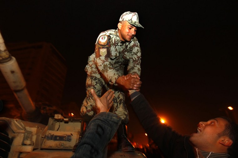 February 11, 2011: Anti-government protesters shake hands with an army officer atop a tank in Tahrir square in Cairo. A furious wave of protest finally swept Egypt's President Hosni Mubarak from power after 30 years of one-man rule, sparking jubilation on the streets and sending a warning to autocrats across the Arab world and beyond. (Yannis Behrakis/Reuters)