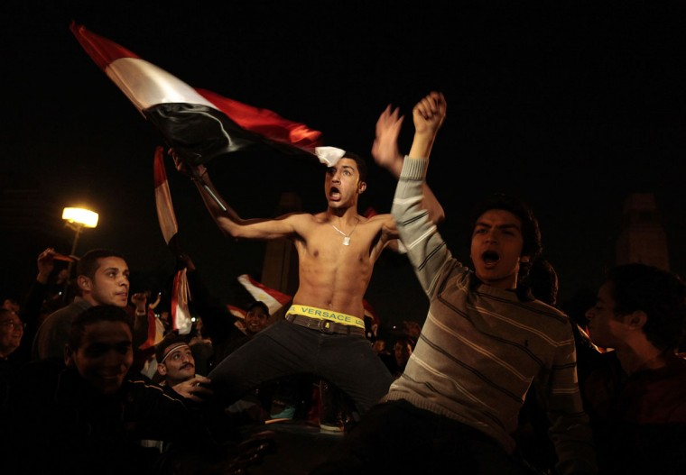 February 11, 2011: Anti-government protesters celebrate inside Tahrir Square after the announcement of Egyptian President Hosni Mubarak's resignation in Cairo. Egypt's Vice President Omar Suleiman said that Mubarak had bowed to pressure from the street and had resigned, handing power to the army. (Dylan Martinez/Reuters)