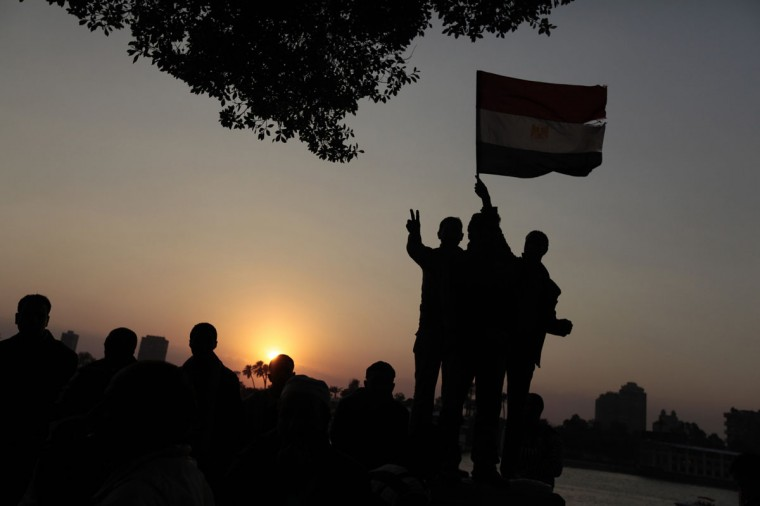 February 11, 2011: The sun sets on protesters as celebrate inside Tahrir Square after the announcement of Egyptian President Hosni Mubarak's resignation in Cairo. (Dylan Martinez/Reuters)