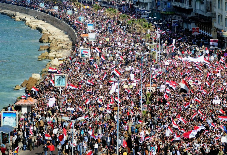 February 11, 2011: Egyptian anti-government protesters march in the coastal city of Alexandria. At least a million Egyptians took to the streets of cities around the country to demand the departure of President Hosni Mubarak, according to an AFP tally of official and witness accounts. (AFP/Getty Images)