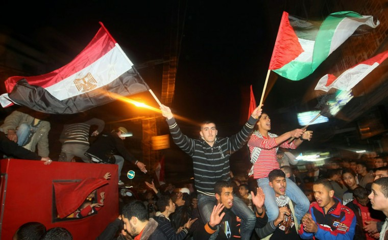 February 11, 2011: Palestinians celebrate in Gaza City following news that embattled Egyptian President Hosni Mubarak stepped down after three-decades of autocratic rule and handed power to a junta of senior military commander. (Mahmud Hams/AFP/Getty Images)
