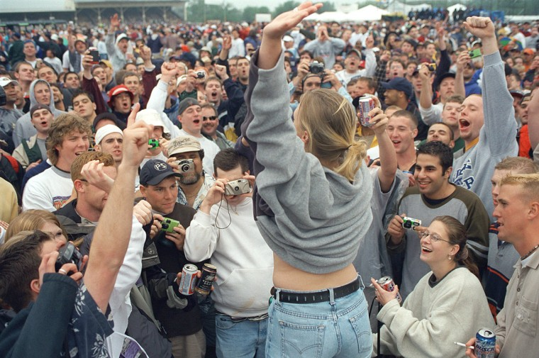 A nineteen-year-old woman flashes for the infield crowd at Pimlico during the 2000 Preakness. (Jerry Jackson/Baltimore Sun)