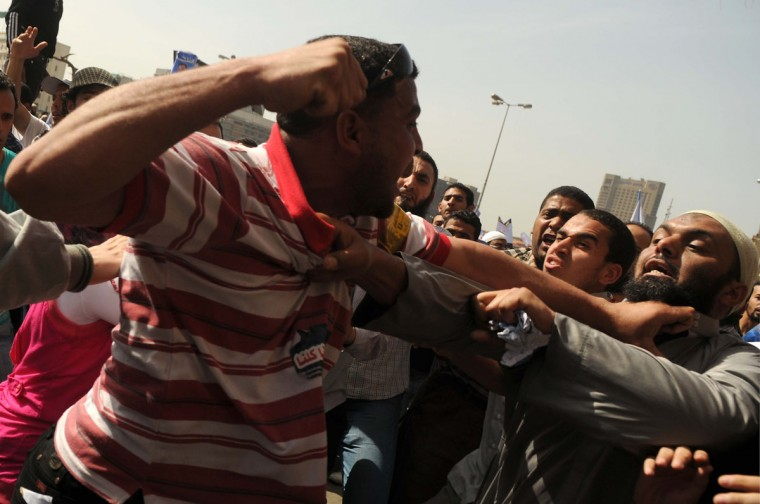 April 6, 2012: An Egyptian man (L) against Salafist candidate Hazem Abu Ismail scuffles with his supporters in Cairo as thousands of his supporters gather nearby to protest against a potential decision to rule him out of Egypt's presidential election because his mother reportedly held U.S. nationality. Under the country's electoral law, all candidates for the presidency, their parents and their wives must have only Egyptian citizenship. (Mohammed Hossam/AFP/Getty Images)