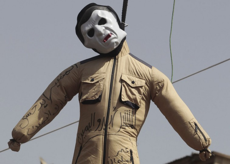 "April 26, 2012: An effigy depicting former Egyptian president Hosni Mubarak and Field Marshal Mohamed Hussein Tantawi, the head of the ruling Supreme Council of the Armed Forces (SCAF), is seen at Tahrir Square in Cairo. Egypt's election committee announced on Thursday the list of 13 candidates for the presidential election which will be held on May 23 and 24. The Arabic words read ""Tantawi, the right hand of Mubarak."" (Amr Abdallah Dalsh/Reuters)"
