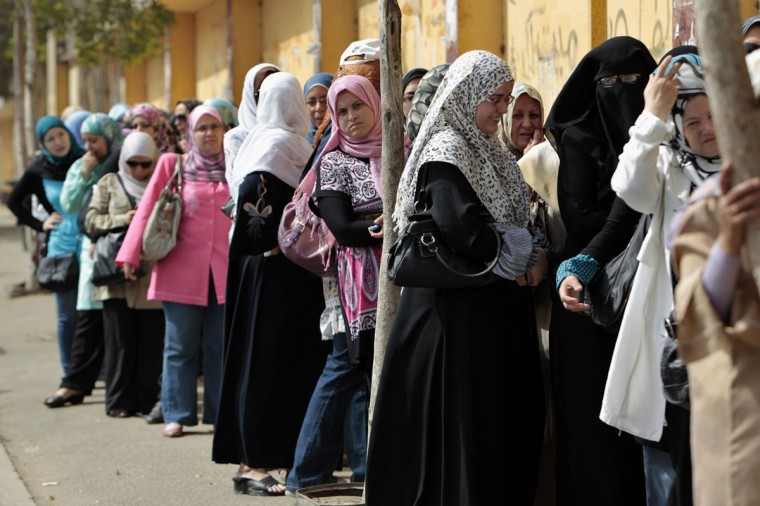 May 23, 2012: Women line up waiting to cast their vote at a polling station in Cairo. Egyptians began voting freely on Wednesday for the first time to pick their president in a wide open election that pits Islamists against men who served under deposed leader Hosni Mubarak. (Ammar Awad/Reuters)