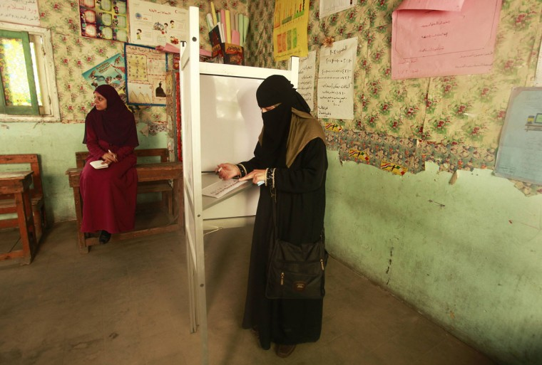 May 23, 2012: A woman marks her vote before casting it at a polling station in Cairo. (Suhaib Salem/Reuters)