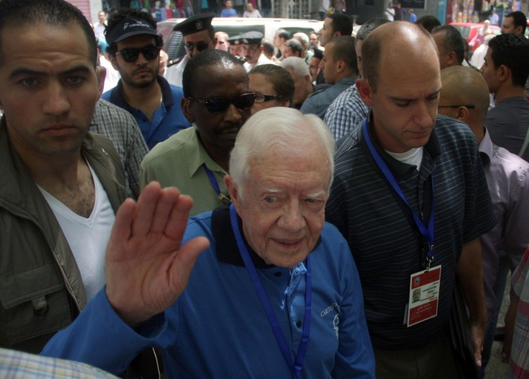 May 23, 2012: Former U.S. President Jimmy Carter, who is in Egypt with a group from his Carter Center to help monitor the end of the final round of Egypt's parliamentary elections, waves as he arrives outside a polling station in Cairo. (Stringer/Reuters)