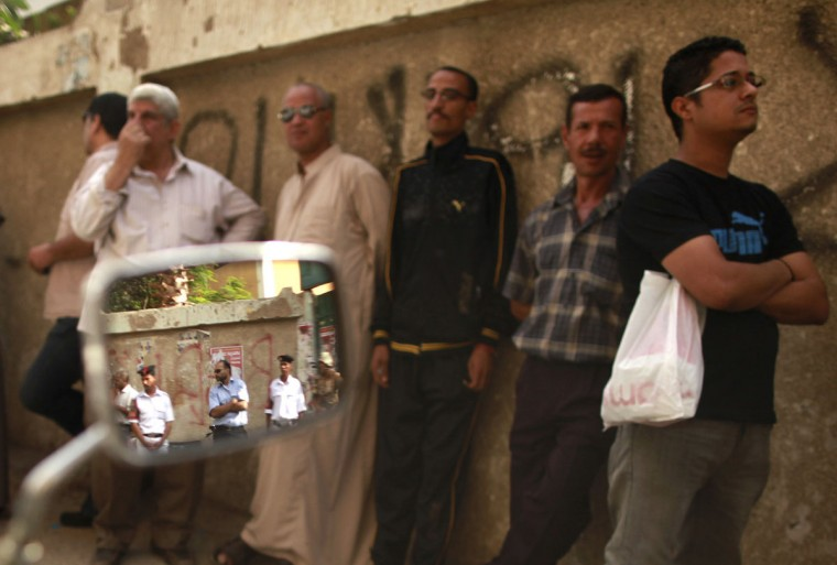 May 23, 2012: More voters wait outside a polling station in Cairo. (Mohammed Salem/Reuters)